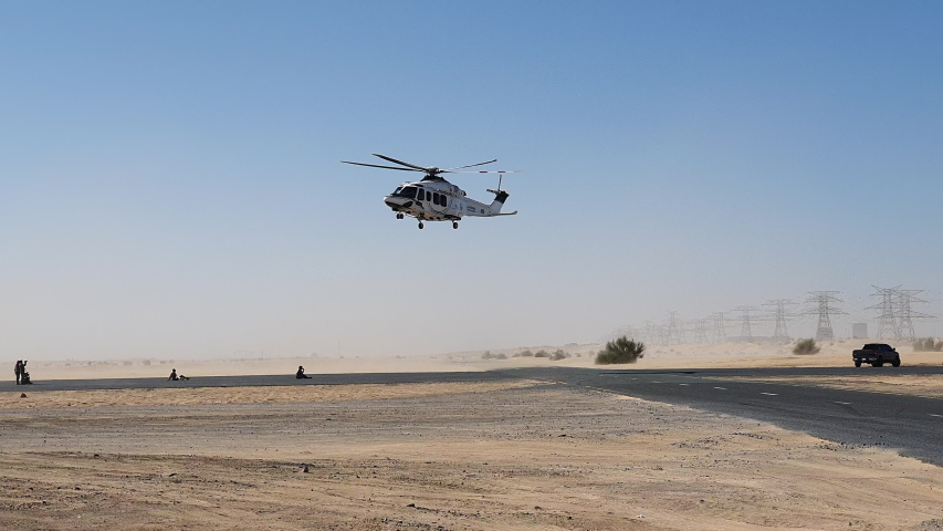 Police helicopter in the desert. Police training and rescue operation concept.