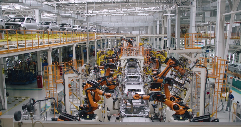 BELARUS, BORISOV - AUGUST 7, 2019: Automobile plant, modern production of cars, car body welding process, robots at work, build process in automated production line, timelapse.