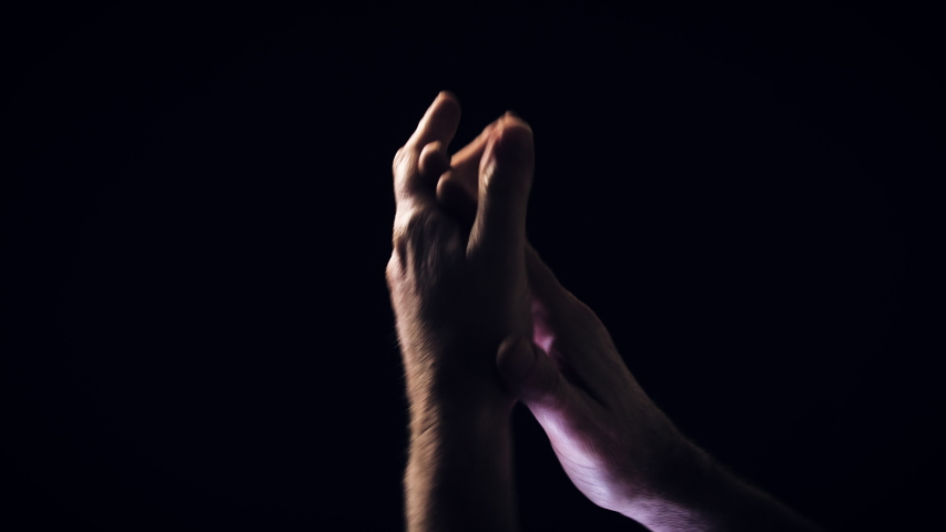Male hands clapping against a black background. | Shutterstock HD Video #1045011871