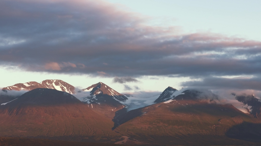 Time Lapse of  the Akka massif at sunset. From RAW Source. Location: Stuor Muorkke National Park, northern Sweden, Scandinavia. July of 2018.  Royalty-Free Stock Footage #1045015657