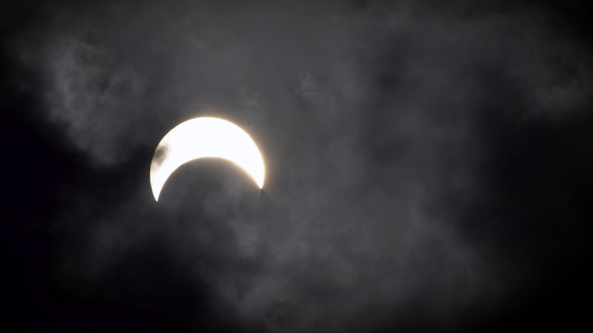 The sun in solar eclipse 2019. Solar eclipse in cloudscape on 2019, 26 December at Thailand. | Shutterstock HD Video #1045033003