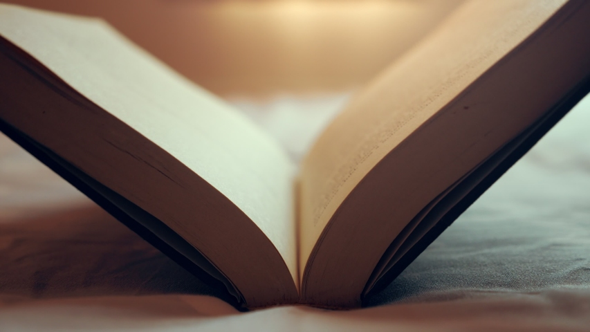 Opening a blank book with light flare, A mysterious book opening. Story of the book. Royalty-Free Stock Footage #1045043767