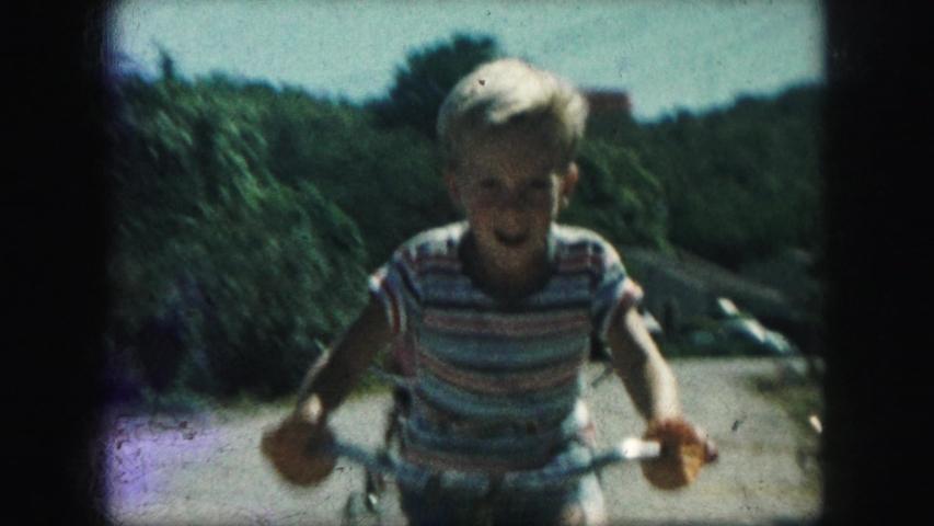 KANSAS CITY MISSOURI-1959: A Rowdy Young Boy Riding His Bike With The Neighborhood Kids