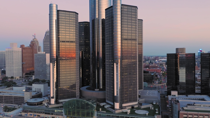 Aerial: Detroit city skyline and traffic at night. Detroit, Michigan, USA. 19 September 2019