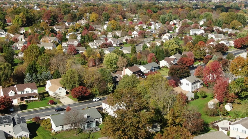 Aerial rotation of suburban community detailing traffic and roadway that connects them with the newest parts of town, Lititz, Lancaster County, Pennsylvania | Shutterstock HD Video #1045085224