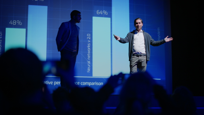 Business Conference Stage: Indian Tech Startup CEO Presents Firm's Newest Product, He's Holding Laptop and Does Motivational Talk about Science, Technology, Entrepreneurship, Software Development | Shutterstock HD Video #1045096558