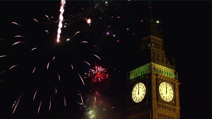 Fireworks display over Big Ben in London, UK at night. Dark Sky Behind. Night. Close