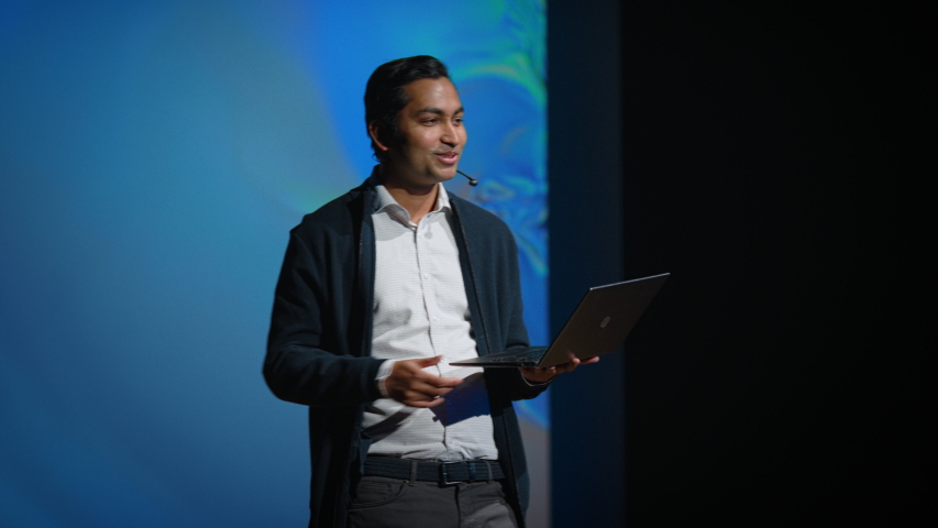 Business Conference Stage: Indian Tech Startup Chief Engineer Presents Firm's Newest Product, He's Holding Laptop and Does Motivational Talk about Science, Technology, Entrepreneurship, Software  | Shutterstock HD Video #1045102456
