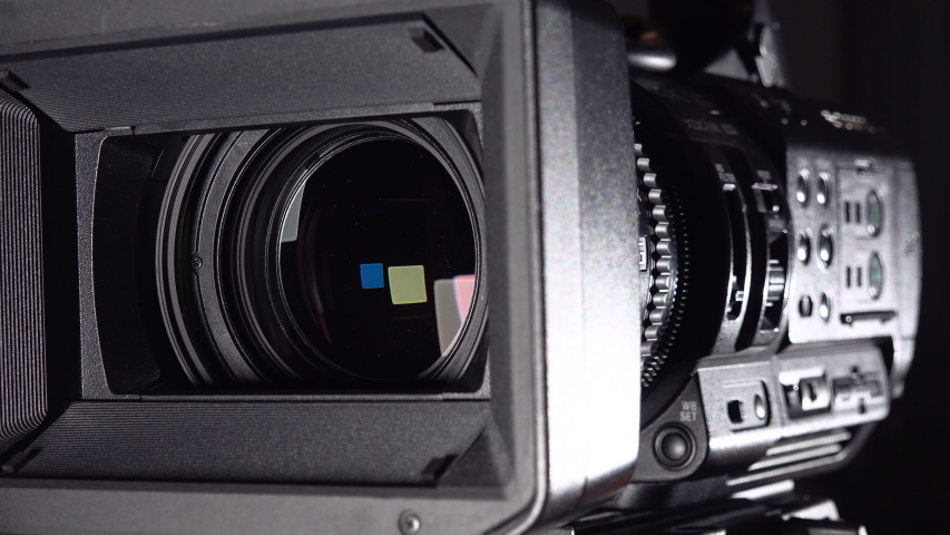 Professional video camera close-up.  Panning And Zooming Video Camcorder Lens 4k | Shutterstock HD Video #1045104862