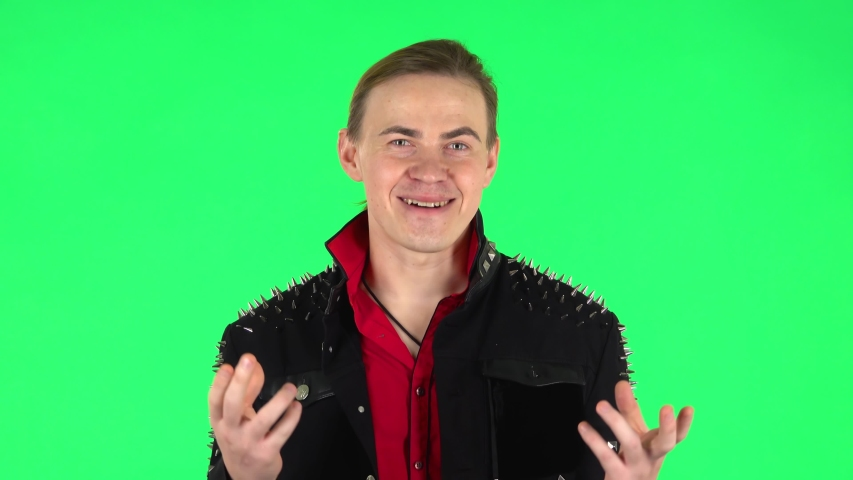 Guy is reporting and tells a lot of interesting informations. Green screen | Shutterstock HD Video #1045138900
