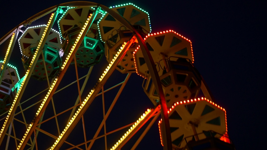 Ferris wheel turning detail of carriages at night amusement park Royalty-Free Stock Footage #1045184194