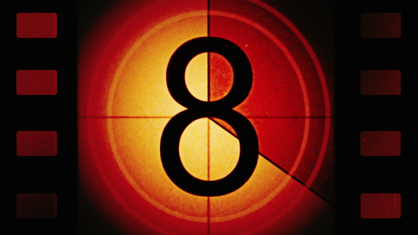 Red Universal Countdown Leader. High contrast. Film perforations or perfs. Countdown Clock from 10 to 0. Old film rolling effect with details, scratches, markers, grain. 4K Film Burn Effect. Film reel