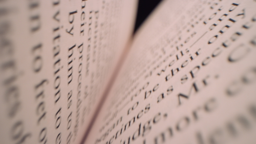 Fast moving macro view past inside of book as it slowly closes filmed on RED 8K | Shutterstock HD Video #1045266838