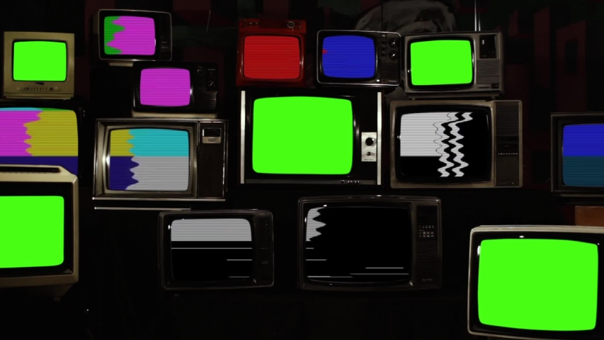 """Broken Old TVs with Color Bars and Five Retro TVs turning on Green Screens. Zoom In. You can Replace Green Screen with the Footage or Picture you Want with """"Keying"""" effect in After Effects. Royalty-Free Stock Footage #1045287769"""