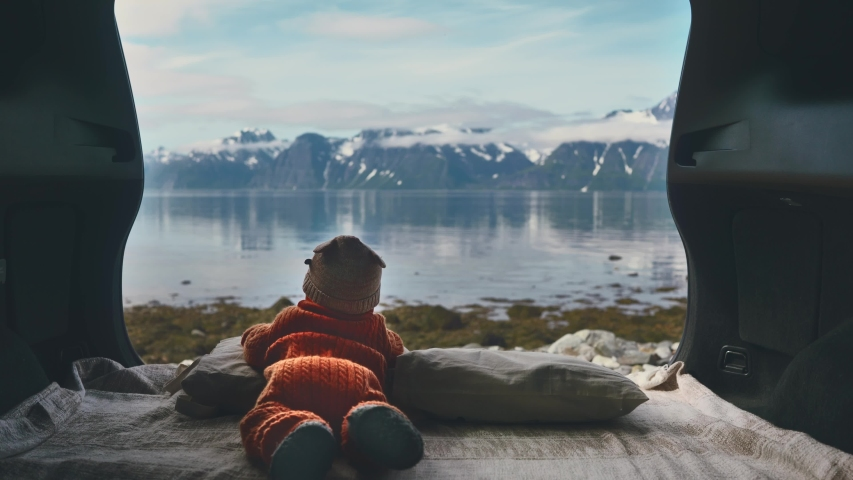Infant baby family travel road trip child enjoying mountains and sea view from camping car travel lifestyle kid outdoor in Norway   Shutterstock HD Video #1045308985