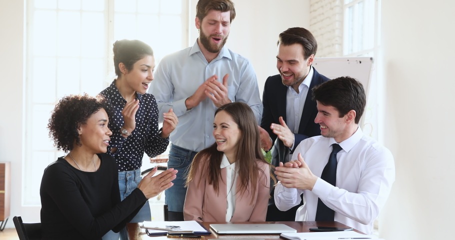 Friendly multiethnic business team coworkers congratulate happy proud best female leader winner applaud in office, diverse employees group praise colleague for professional achievement reward concept Royalty-Free Stock Footage #1045309066