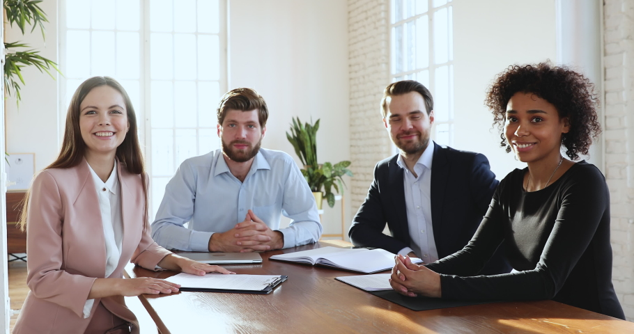 Diverse executive team make conference video call looking at camera, four business people group talking to webcam do online chat participate internet conference distance office meeting, web cam view Royalty-Free Stock Footage #1045309099