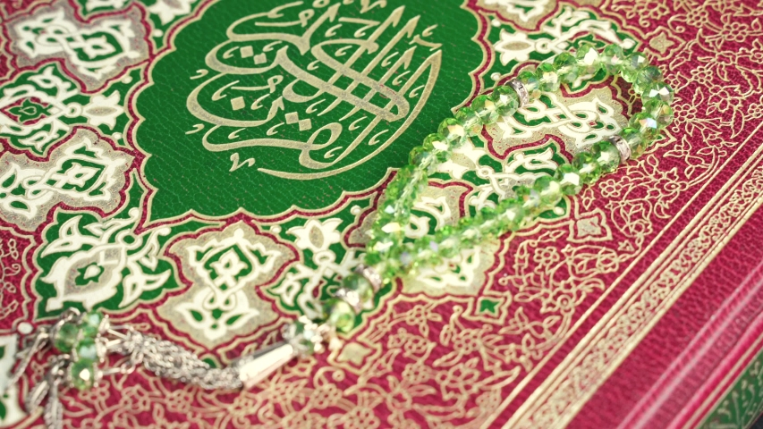 Beads on top of Holy Quran , Shot of Holy Quran Muslims Holy Book Quran Kareem with a prayer rug and paternoster Tasbeeh - 4K  | Shutterstock HD Video #1045324009