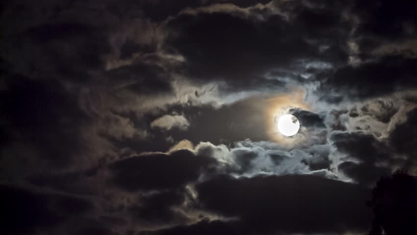 Shot of a bright full moon among moving clouds. #10453592