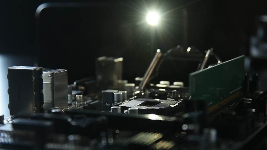 Motherboard assembly components on black background Royalty-Free Stock Footage #1045388401