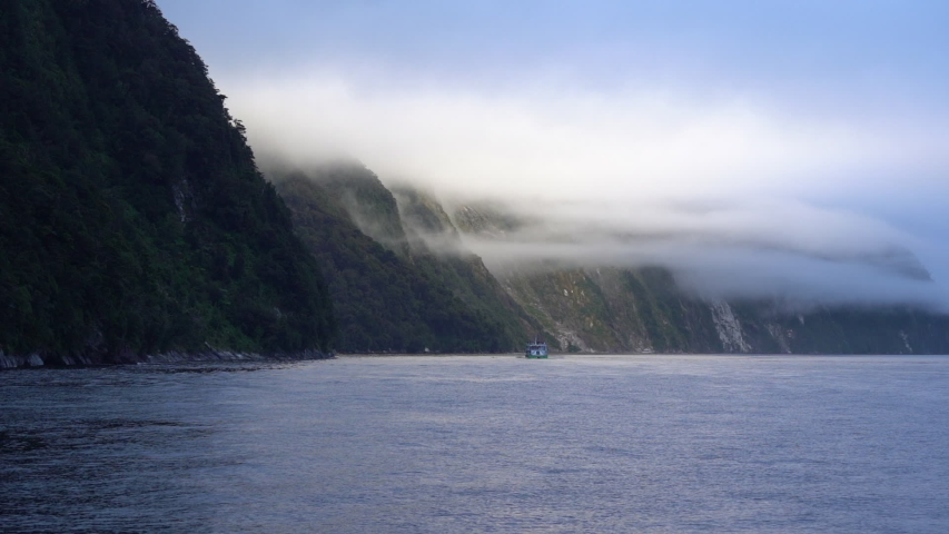 Milford Sound New Zealand ferry boat cloudy landscape scenery moody slow motion | Shutterstock HD Video #1045390000