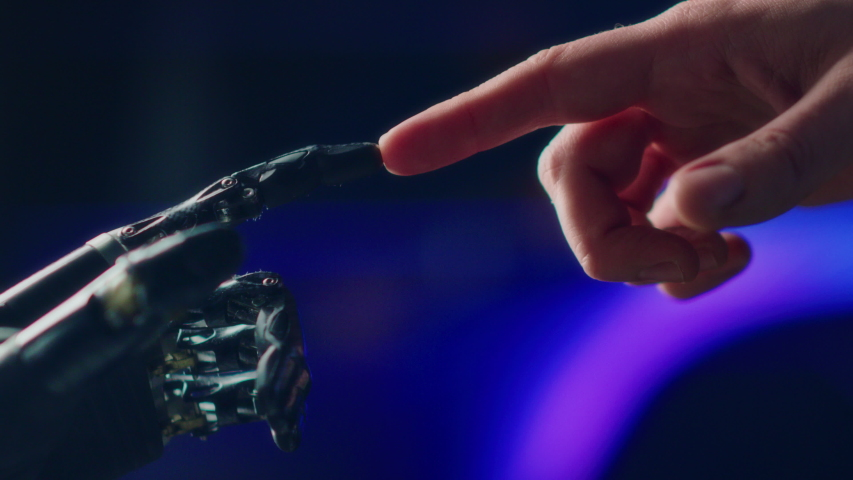 Humanoid Robot Arm Touches Human Hand. Humanity and Artificial Intelligence Unifying Gesture.Technology Merges with Creative Human Mind. Futuristic Concept Inspired by Michelangelo's Creation of Adam