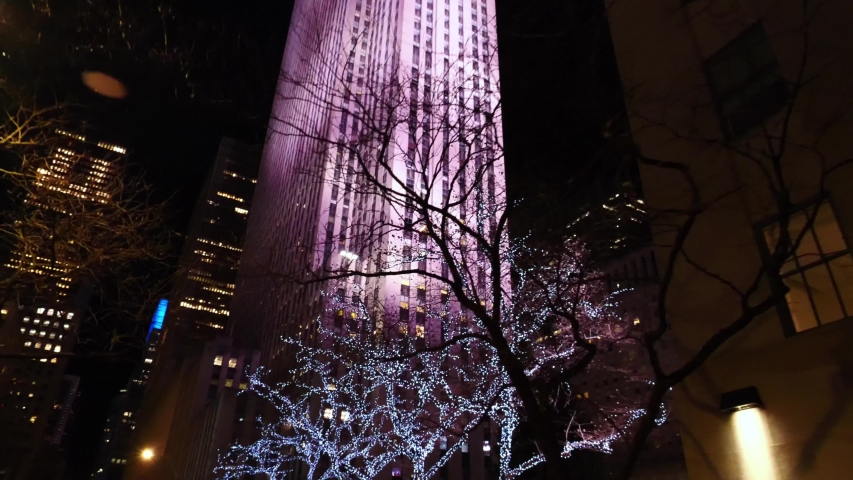 NEW YORK CITY, USA - January 15, 2020: New York City Manhattan street view at night near Rockefeller center during Christmas. 4k slow motion. NYC is a modern urban city, famous USA tourism destination