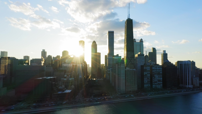Beautiful Sunset in Chicago through buildings - Sun set in Chicago on Lake michigan aerial shot of downtown