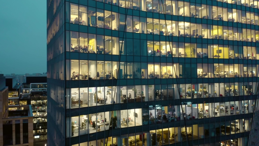 Aerial view of office windows in a modern skyscraper in the center of Warsaw at night. Close-up of windows of offices in a skyscraper, business center of Warsaw. Royalty-Free Stock Footage #1045472758