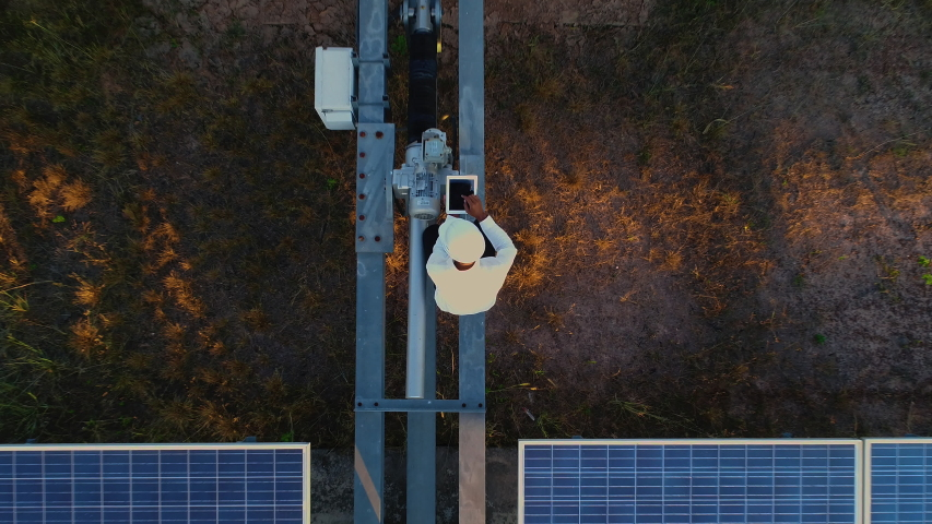 Technician and investor Using Infrared Drone Technology to Inspect Solar Panels and Wind Turbines in Solar cell Farm, Solar cells will be an important renewable energy of the future.