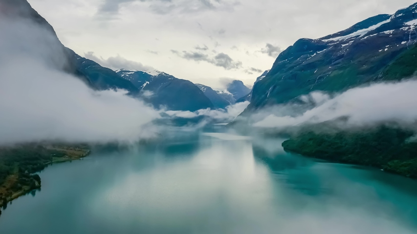 Beautiful Nature Norway natural landscape lovatnet lake flying over the clouds. Royalty-Free Stock Footage #1045524979