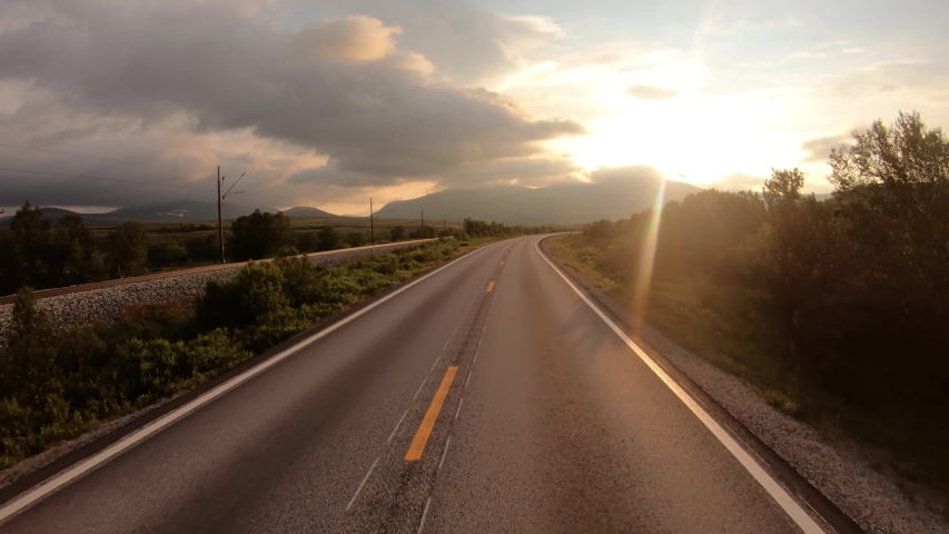 Driving a Car on a Road in Norway at dawn | Shutterstock HD Video #1045525843