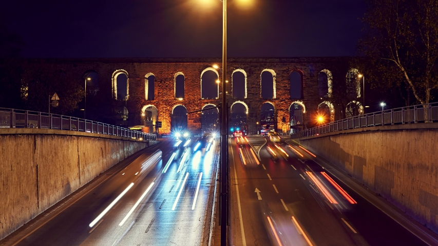 Time lapse clip near Valens Aqueduct (Bozdogan Su Kemeri) in evening with traffic of cars, Istanbul, Turkey. It was a water-providing system of the Eastern Roman capital Constantinpole | Shutterstock HD Video #1045527481