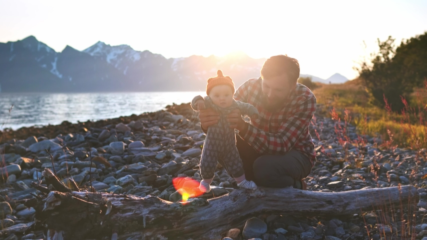 Father playing with baby travel together enjoying sunset mountains view family vacations man and child outdoor in Norway healthy lifestyle    Shutterstock HD Video #1045533463