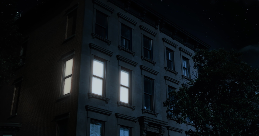 A nighttime exterior establishing shot of the upper floors of a typical Brooklyn brownstone residential home as a room lights up then turns off.	Day matching: 1045545877 | Shutterstock HD Video #1045548061