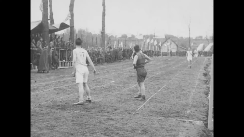 CIRCA 1910s - Soldiers of the 35th and 77th Infantry Divisions participate in a relay race n Olympic sporting event, Le Mans Embarkation Center.