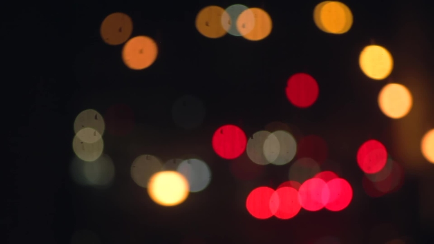 Bokeh of cars and traffic lights at night. Bokeh of City Night Traffic. Round colorful bokeh shine from car lights in traffic jam on city street.  | Shutterstock HD Video #1045578277