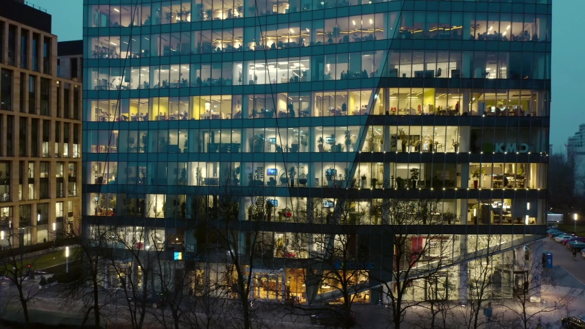 Aerial view of office windows in a modern skyscraper in the center of Warsaw at night. Poland. 14. January. 2020. Close-up of windows of offices in a skyscraper, business center of Warsaw.