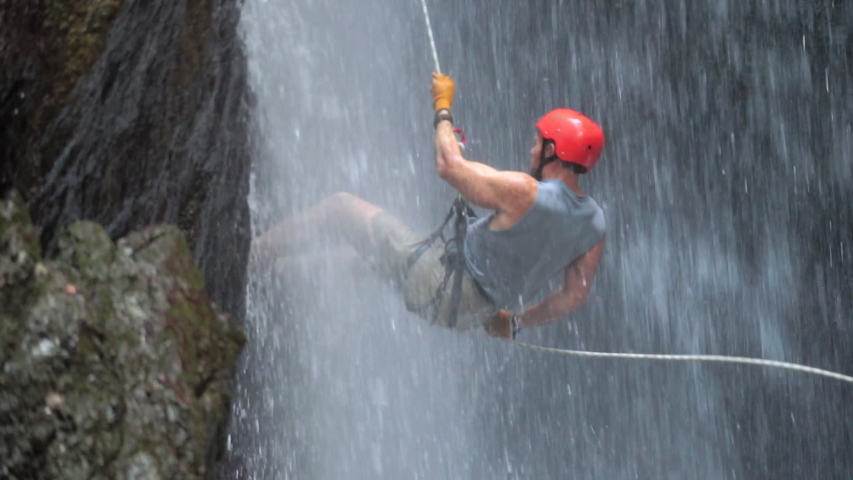 San Jose, Costa Rica - 11/13/2018: Rappelling Down Waterfall In Costa Rica - Canyoning in Central America Waterfall