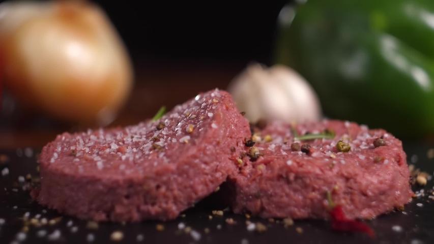 Plant based vegan burger meat, fake vegeterian beef meat close up, fresh impossible veggie food, beyond meat
