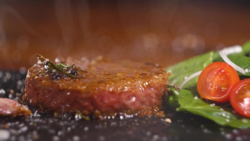Plant based vegan burger meat, fake vegeterian beef meat close up, fresh impossible veggie food, beyond meat | Shutterstock HD Video #1045586761