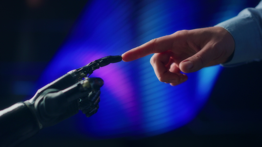 Humanoid Robot Arm Touches Human Hand, Connecting Fingers. Humanity and Artificial Intelligence Unifying Gesture.Technology Merges with Creative Human Mind. Inspired by Michelangelo's Creation of Adam