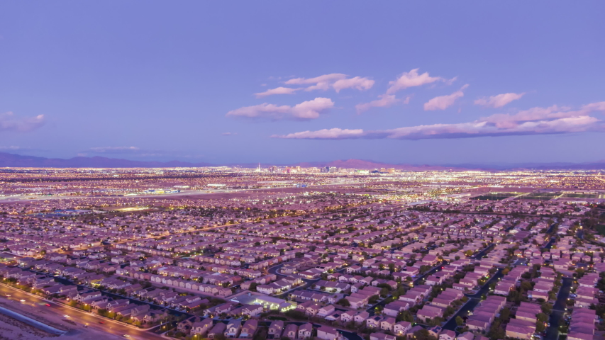 Las Vegas Cityscape at Sunset. Nevada, USA. Aerial Hyper Lapse, Time Lapse. Drone Flies Sideways and Upwards | Shutterstock HD Video #1045673161