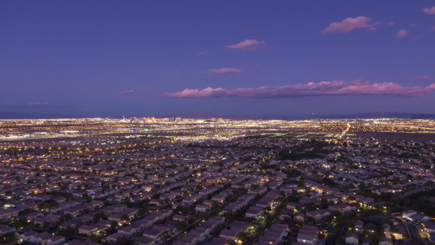 Las Vegas Skyline in Evening Twilight. Nevada, USA. Aerial Hyper Lapse, Time Lapse. Drone Flies Sideways