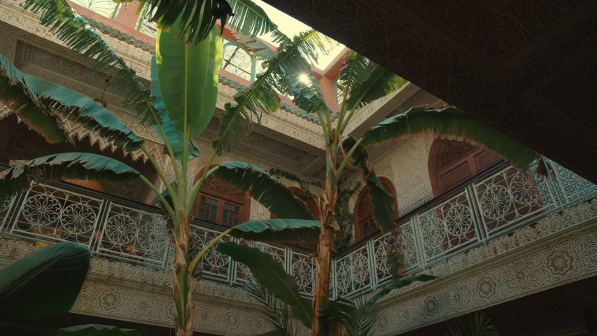 Beautiful Riad in Morocco.  With a nice sun flare and palm trees in het Riad.