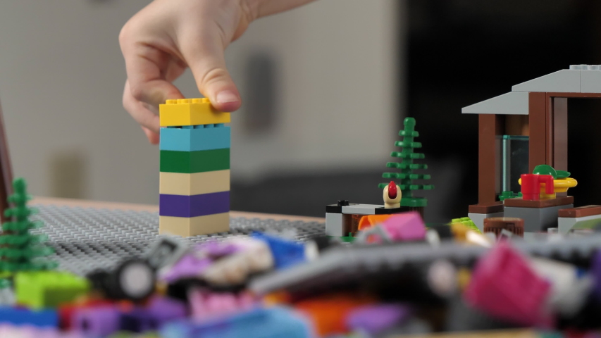 Milwaukee, Wisconsin / United States - February 01 2020: Cute little boy (preschooler) is playing with Lego building bricks (camper park set). Educational  Building Blocks for kids, early childhood ed