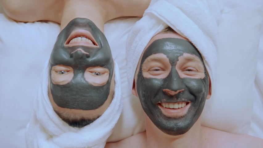 Close up pair have fun laughing woman and man with cosmetic mask on face beauty treatment for family | Shutterstock HD Video #1045737784