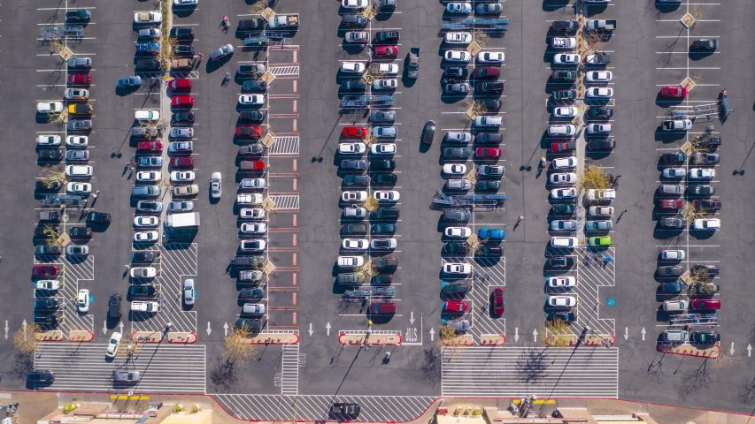 Aerial timelapse of a busy, crowded supermarket parking lot in daytime USA | Shutterstock HD Video #1045739143