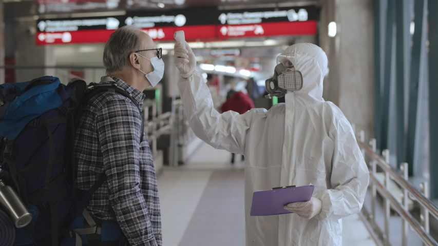 Prevention of transmission Novel Coronavirus Covid-19  2019-nCoV. Screening passengers, travellers for Chinese virus symptoms. Temperature checkpoints in International airports. People may be infected Royalty-Free Stock Footage #1045755418