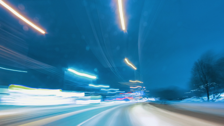 Long exposure motion timelapse with car driving through the night city streets with light trails. Car motion timelapse in capital city Vilnius, Lithuania. | Shutterstock HD Video #1045756081